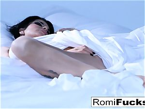 Solo fun on the sofa with the busty sex industry star Romi Rain