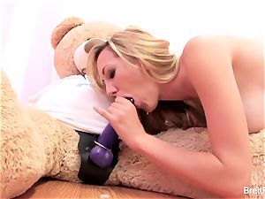 Brett Rossi plays with a wedged bear's strap-on dildo