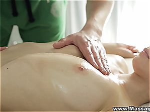 diminutive cutie is melting in the masseur's mitts