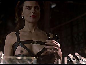 brunette Lena Olin in lingerie displays off her puny globes