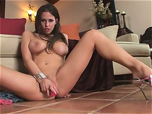naughty Rachel Roxx slips a immense toy into her dirty little cooter